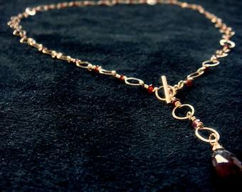 "gold garnet necklace, front fastening, adjustable to 18"", 14k gold filled, garnet necklace, with a garnet pendant, very feminine, very sweet"