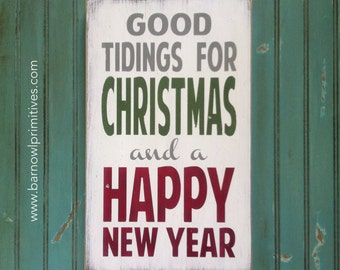Good Tidings for Christmas and a Happy New Year Heavily Distressed Typography Word Art Sign in Vintage Style