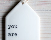 porcelain tag screenprinted text you are beautiful.