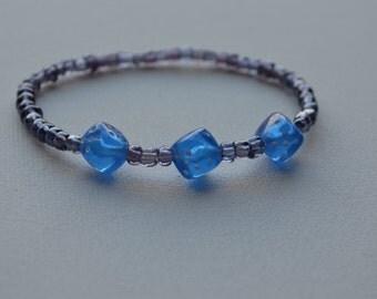 Bunco bracelet, purple glass seed beads with 3 blue dice, stretch bracelet