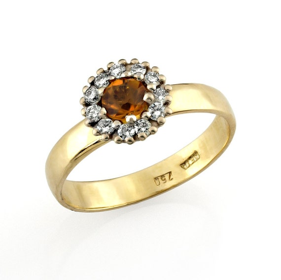 princess diana style 14k gold engagement ring by