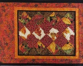 Handcrafted Set of Four Quilted Place Mats with bright fall fabrics orange and black