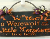 A Witch, A Werewolf and their Little Monsters Live Here- Halloween Sign with cast iron scroll on top