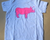 Florescent pink rhino on white t-shirt