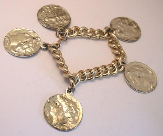 Vintage coin charm bracelet. Goldtone
