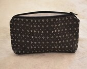 zippered cosmetic bag in BLACK and WHITE dotted  MARIMEKK0 coated cotton