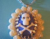Delicately Dangerous skull and crossbones cameo necklace in skull frame setting