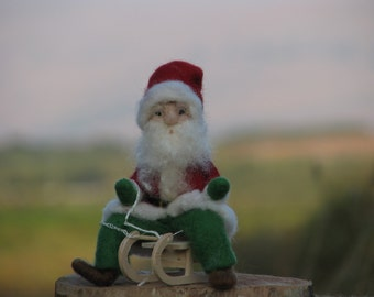 Needle felted Santa Claus on sledge