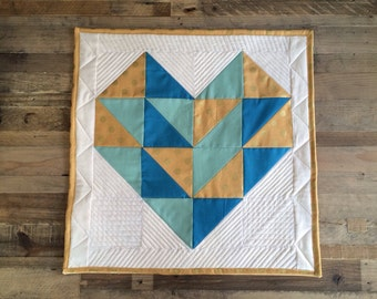 Quilted geometric heart wall hanging
