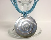 4-Strand Light Blue Spiral Shell Pendant Necklace
