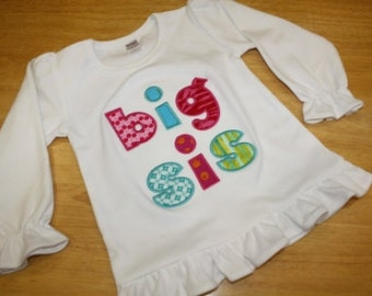 Girls white ruffled tee with big sis applique