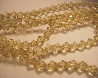 "Yellow Glass Beads: Small Light Transparent Faceted Bicones, 6mm, approx. 65 pcs., One 15 1/2"" strand (cd)"