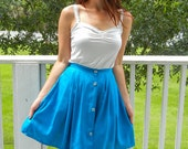 Bright blue vintage skirt with blue buttons