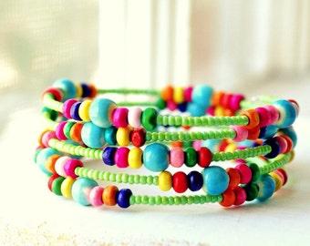 colorful beaded memory wire bracelet aqua and green rainbow