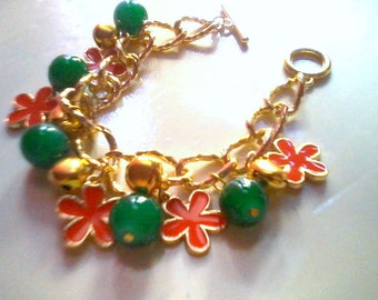 Flower charm bracelet with gold tone bells (green beads/red flower) (free combined shipping)