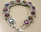 White enamel bracelet with Red Auroura Crystals