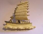 Hard to find Hattie Carnegie Faux Ivory Junk Boat Brooch. Book piece