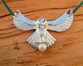 "A ""Fly me to the moon..."" Owl pendant featuring gem eyes and pearl ""catch"" in the talons"