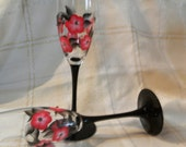 Black stem champagne flutes with red poppies with dark rhinestone centers