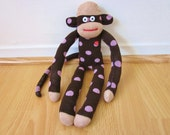 Polka dot sock monkey doll in brown, tan, and pink