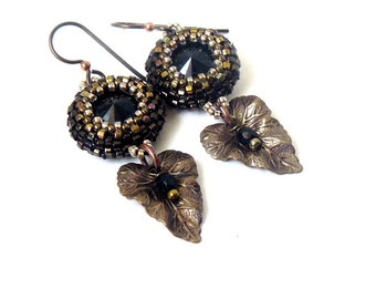 Beaded rivoli dangling earrings with filigree leaves with hypoallergenic niobium earwires in jet black and antique bronze
