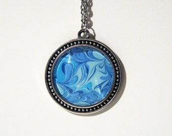 Shades of Blue Hand Painted Round Portable Art Necklace in an Antique Silver Finish - Art to Wear around Your Neck!