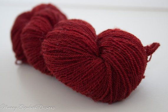 Hand Combed Hand Spun Fine Merino Lace Yarn kettle dyed in Garnet Red