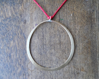 Hammered Brass Circle on Red Silk Cord