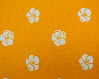 Vintage 1970s fabric in highquality unused cotton with larger printed white flower pattern on strong yellow bottomcolor