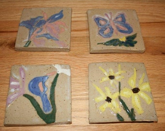 Set of four floral pottery tiles, coasters, decorative art