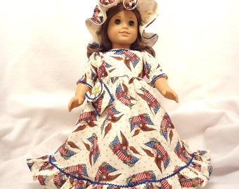 Idependence Day long dress for 18 inch dolls, ruffled.  Red, blue, gold, and brown on an ecru background with blue baby rick-rack trim.