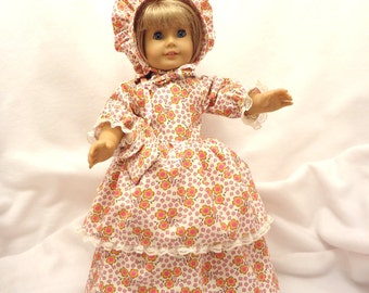Floral print of pink, magenta, gold, and brown on light beige, long dress for 18 inch dolls, with light beige lace trim.