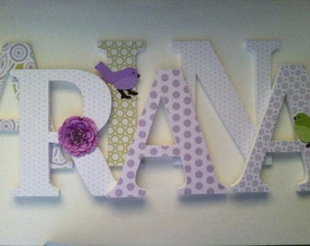 Wooden  nursery letters in  lavender  and green