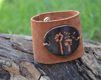 Upcycled suede leather cuff bracelet with dandelion ceramic centerpiece