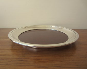 Vintage small round 1960s faux wood and silver Crescent tray.