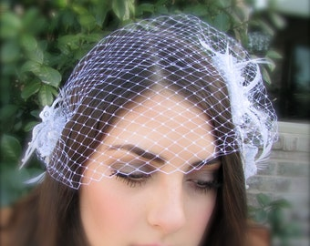 Bridal fascinator white and silver lace veil