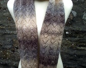 Hand knitted lacy self patterning skinny scarf with flower. Adult women or teenage girls. Brown earth tones.