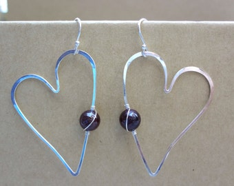 Hammered sterling silver heart shaped earrings with garnet beads. January birthstone. Holiday or Valentine earrings for women and girls.