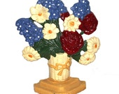 Vintage caste iron doorstop or bookends, cream basket of roses, daisies, and hyacinths on a golden yellow base