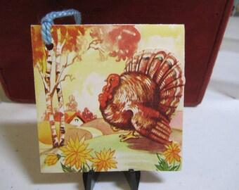 1940's unused die cut Thanksgiving bridge tally turkey walking along path to cottage A-Meri-Card