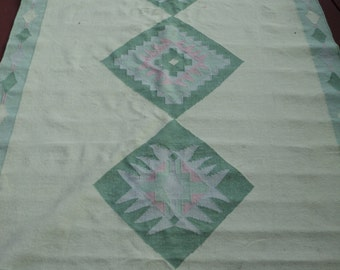 Retro Southwestern Style Woven  Area Rug with Repeating Green and Pink Diamond patterns in Vintage Condition