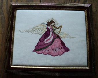 An Angel Among Us, Vintage Counted Cross Stitched Sampler,  Elegant Pink and Maroon Angel  playing a harp with golden wings and halo