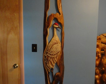 Standing sandhill crane carved and painted