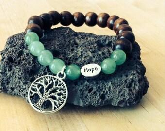 Yoga wood bead bracelet with tree of life hope beads and green gemstone