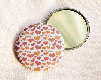 Peach hearts round pocket mirror