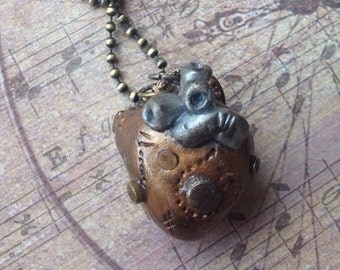 Steampunk Bronze and Silver Heart Necklace - Embedded w/ screw, nail, watch pieces
