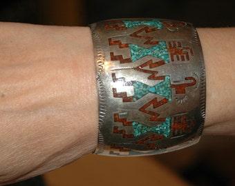 Lovely Wide Vintage Navajo Ortega Shop Turquoise and Coral Chip Inlay Arrowheads And Yeii Dancers Bracelet 72 Grams