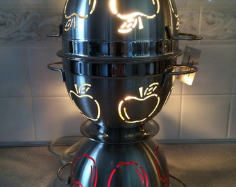 Decorative, dual-purpose kitchen lamp.