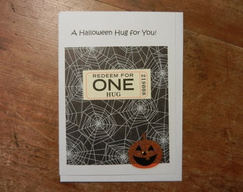 Halloween Handmade Greeting Card with real Hug Ticket and Jack-o-Lanterns and spider webs