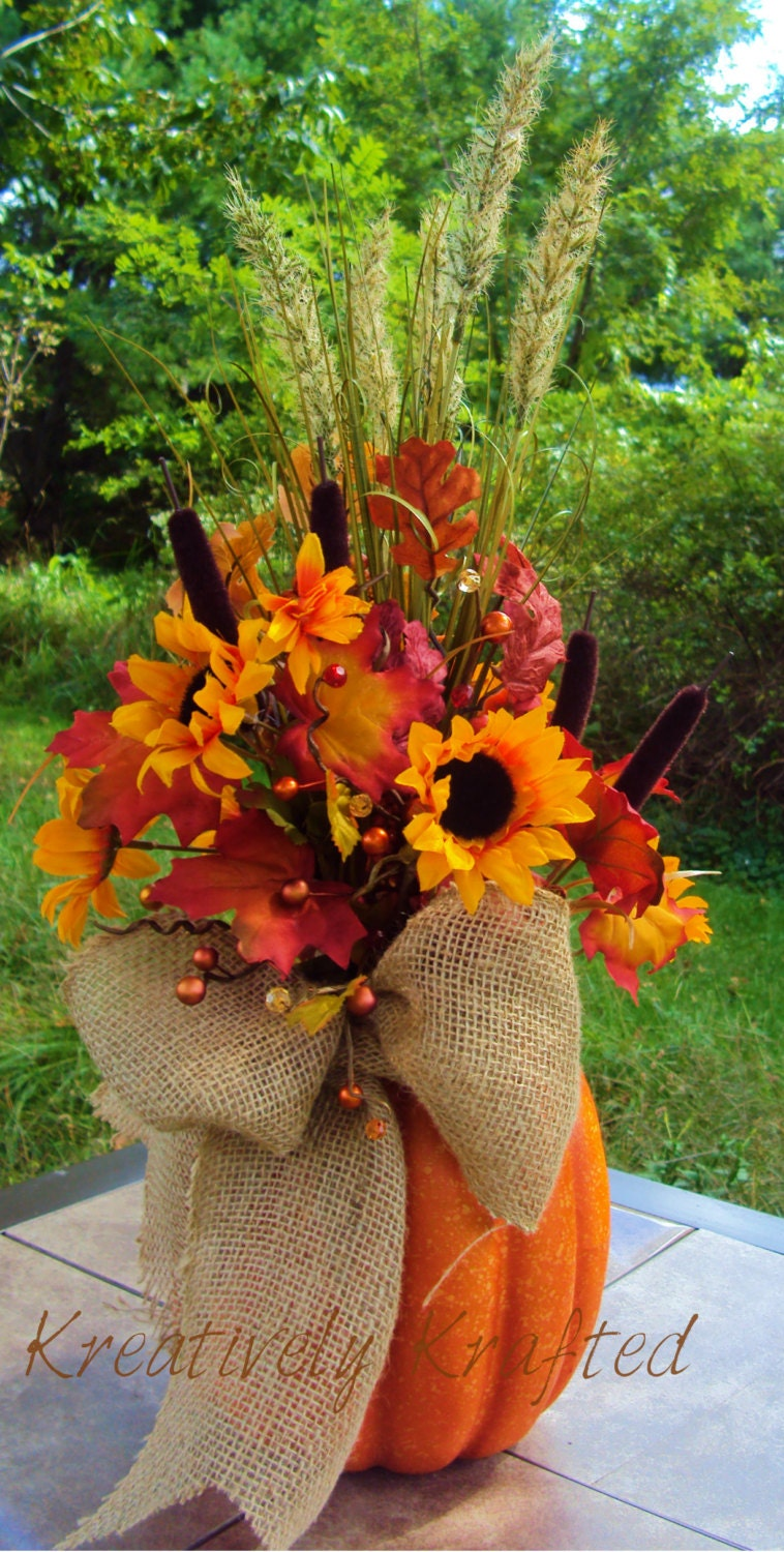 Large pumpkin autumn floral arrangement table centerpiece fall